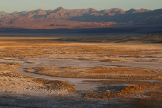 Colorful sunrise over the salt flats of Death Valley, CA