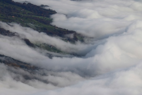 Strong winds whip the fog into fantastic shapes as it moves past Rigi Mountain, Swizerland