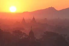 Sunrise is the main event in Bagan. Nearly every day hot air balloons are launched as the sun rises on a hazy field of temples.